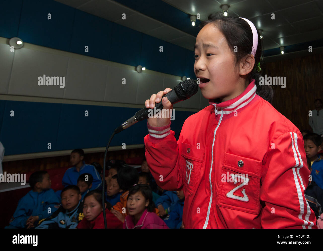 North Korean children singing during a karaoke Songdowon international children's camp, Kangwon Province, Wonsan, Stock Photo