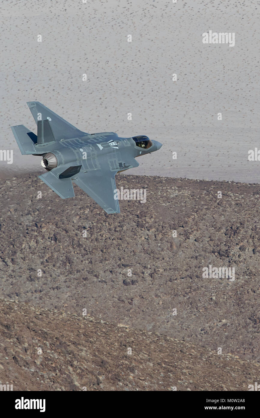 Lockheed Martin F-35A Lightning II Joint Strike Fighter (Stealth Jet Fighter), Flying At Low Level Through A Desert - Stock Image