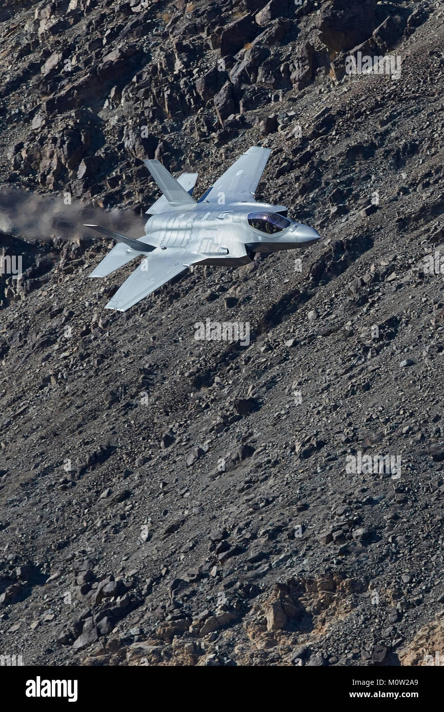 RNLAF Lockheed Martin F-35A Lightning II Joint Strike Fighter (Stealth Fighter), Flying At Low Level Through Rainbow - Stock Image