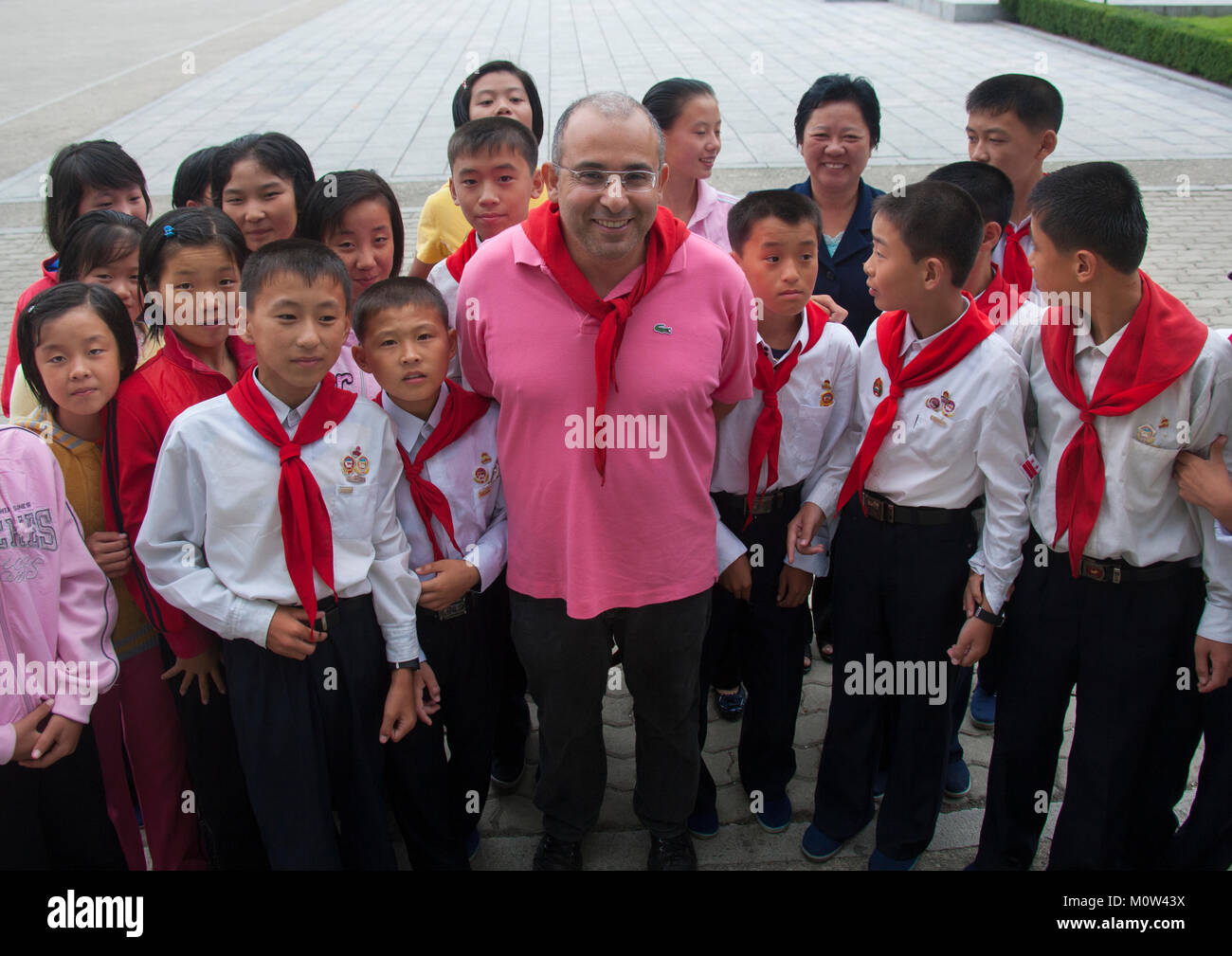 French tourist with North Korean pioneers in Songdowon international children's union camp, Kangwon Province, Wonsan, Stock Photo