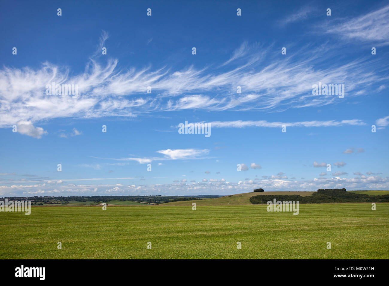 A discrete band of Cirrus cloud against a blue sky, looking north from Compton Abbas Airfield, Dorset. - Stock Image