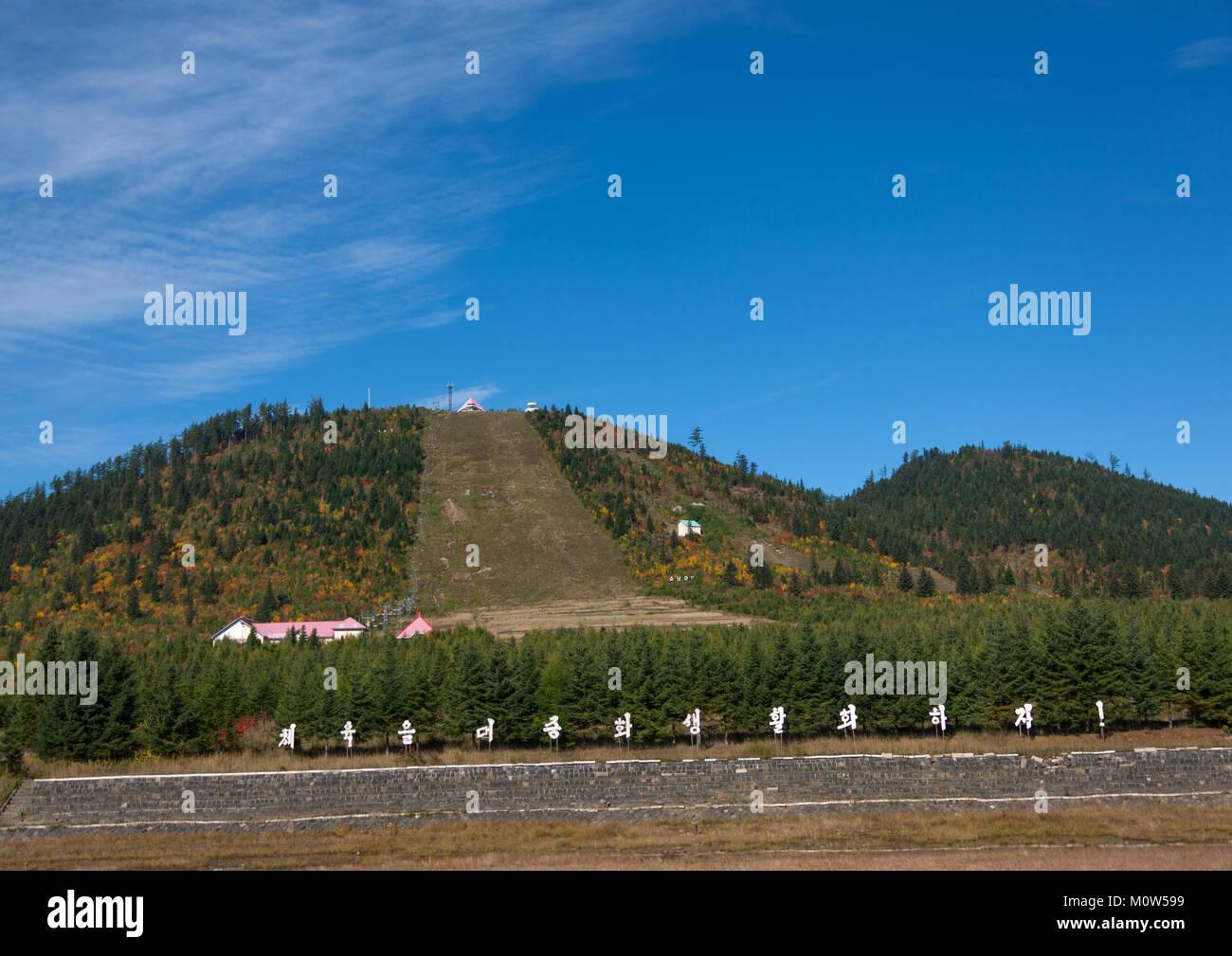 View on Samjiyon hill with skiing slopes in summertime , Ryanggang Province, Samjiyon, North Korea - Stock Image