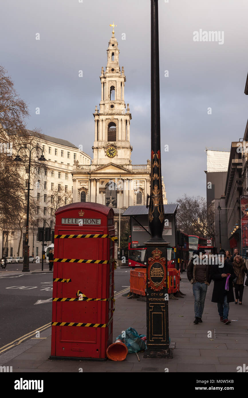 A London street with decommissioned red phone box - Stock Image