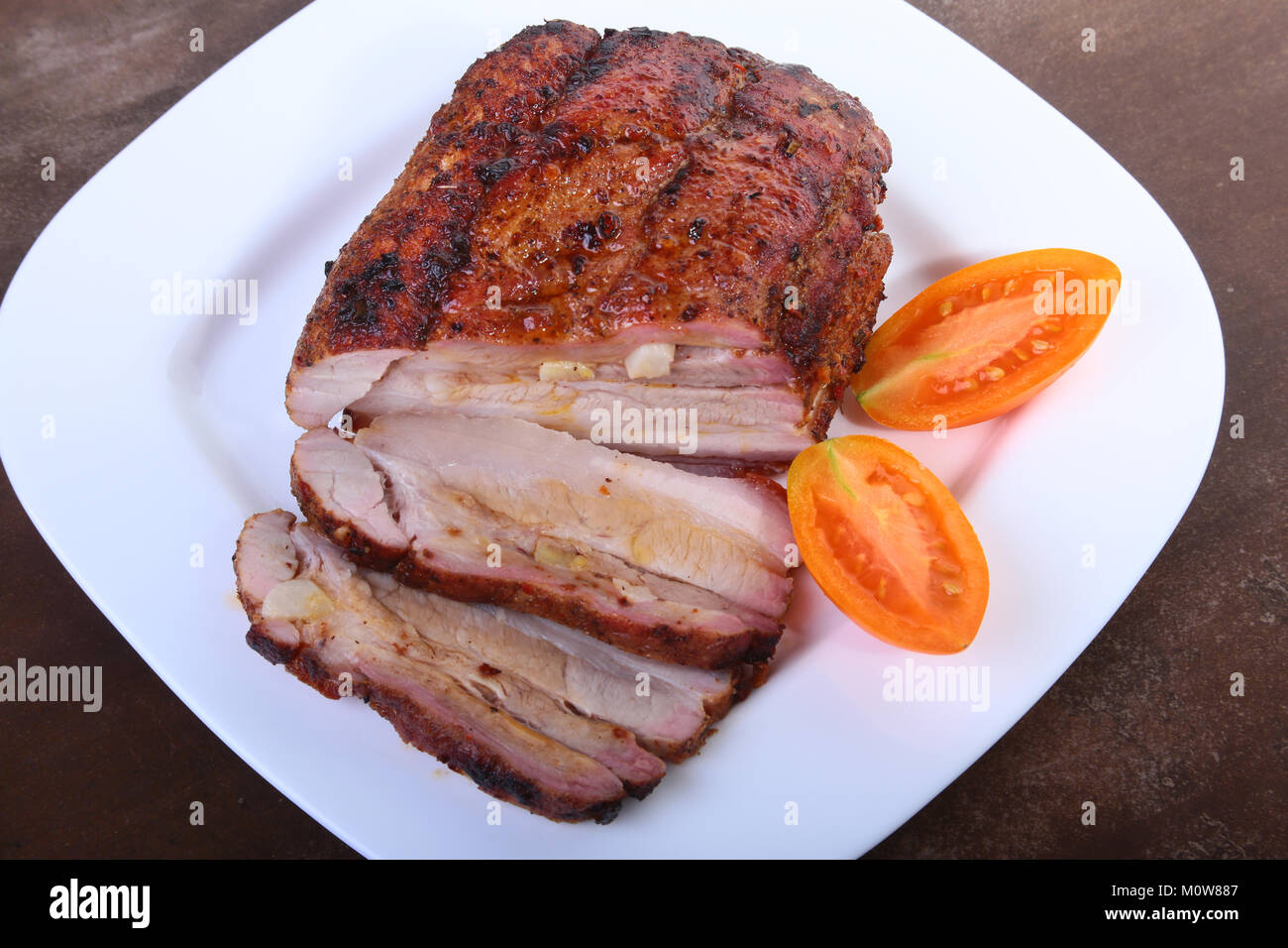 grilled pork chops with tomato and ketchup on plate. Stock Photo