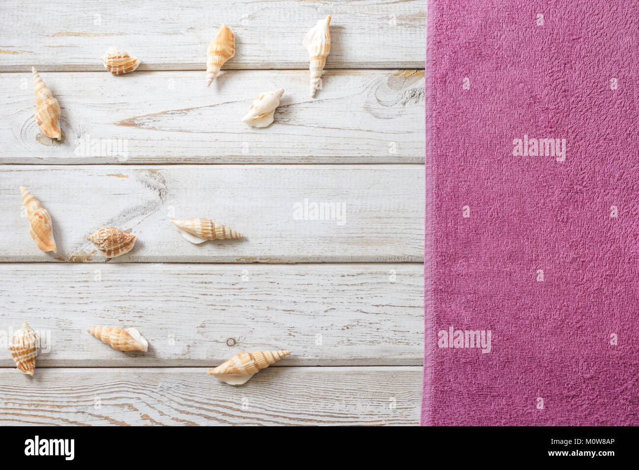 Beach towel and summer accessories on white wooden background. Travel concept. View from above. Blank mock up for Stock Photo