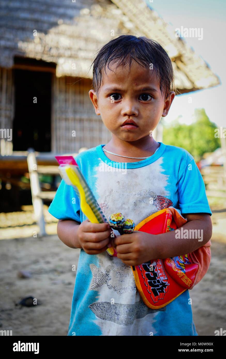 Daklak, Vietnam - Oct 10, 2015. Portrait of boy at small ethnic village in Daklak, Central Highlands of Vietnam. Stock Photo
