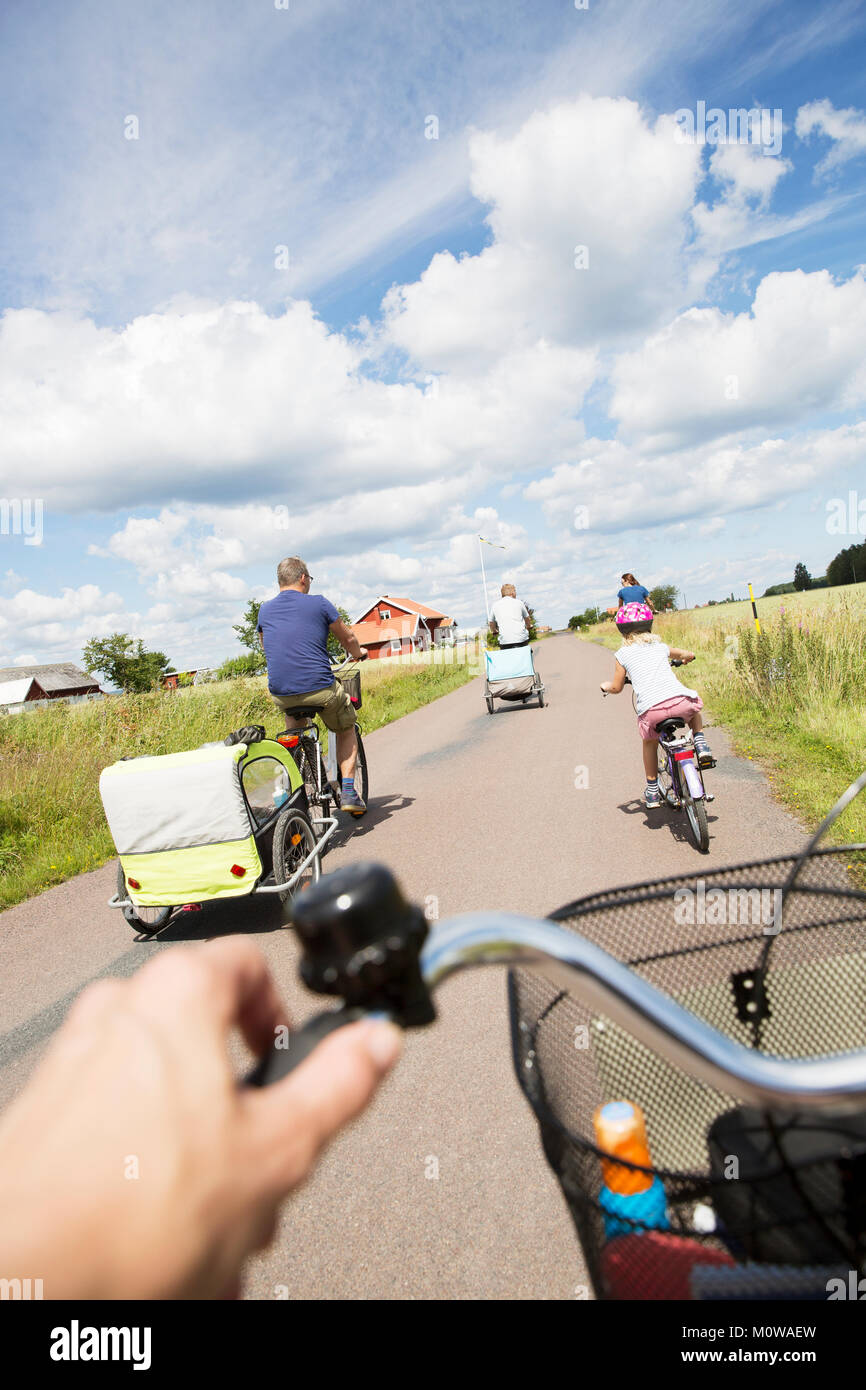 Family cycling in Smaland, Sweden - Stock Image