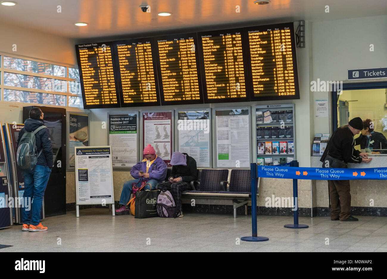 Ticket office and train departure times board in a British railway station in England, UK. - Stock Image