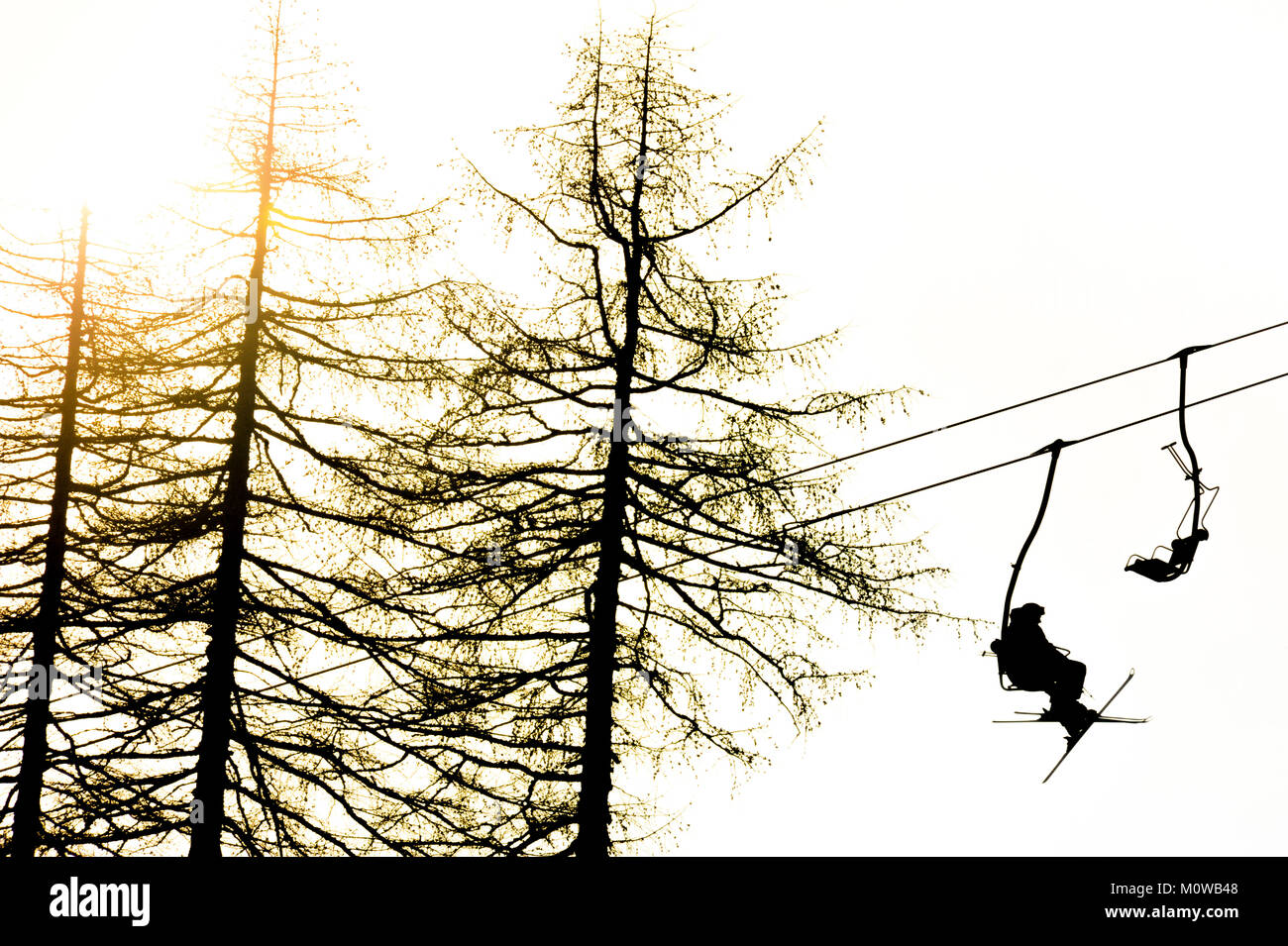 Skiers on chairlift Stock Photo