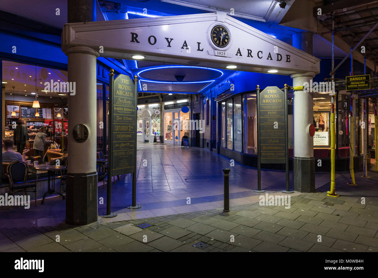 The Royal Arcade small shopping mall lit up at night in Worthing, West Sussex, England, UK. - Stock Image