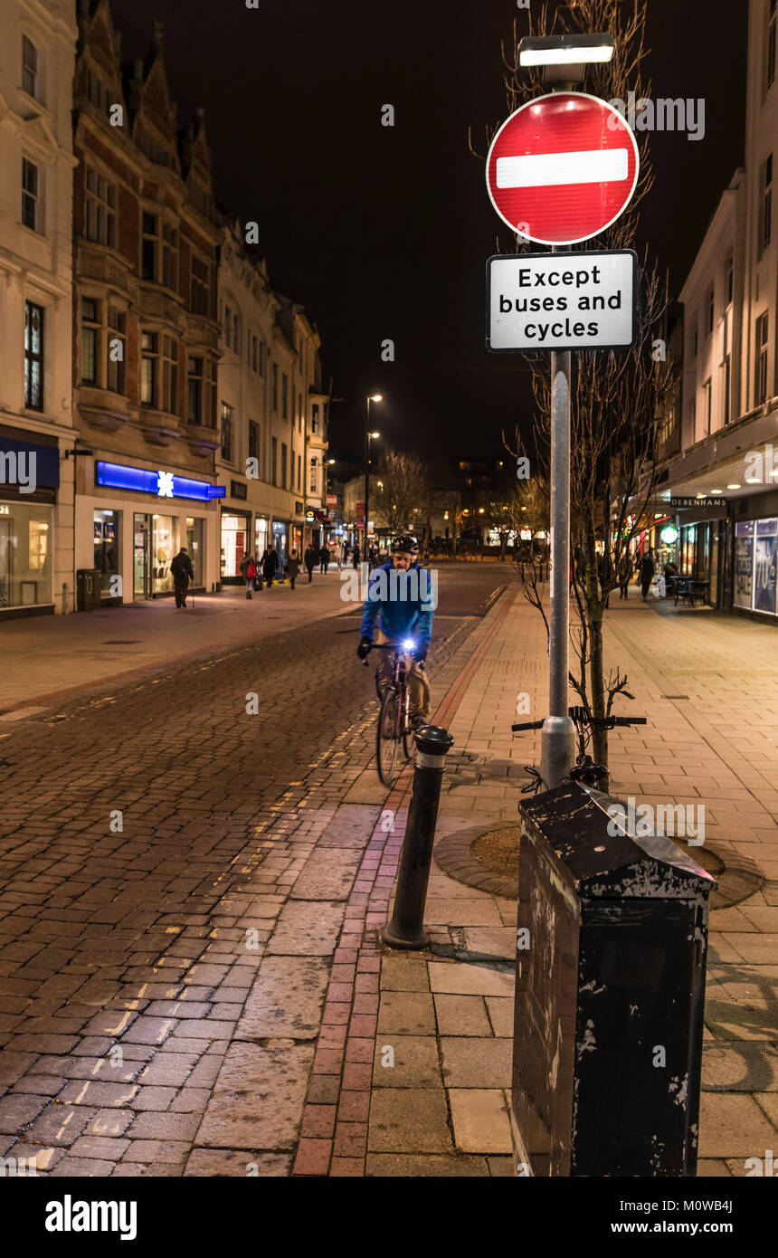 No Entry sign at a pedestrian shopping zone road at night in Worthing, West Sussex, England, UK. - Stock Image
