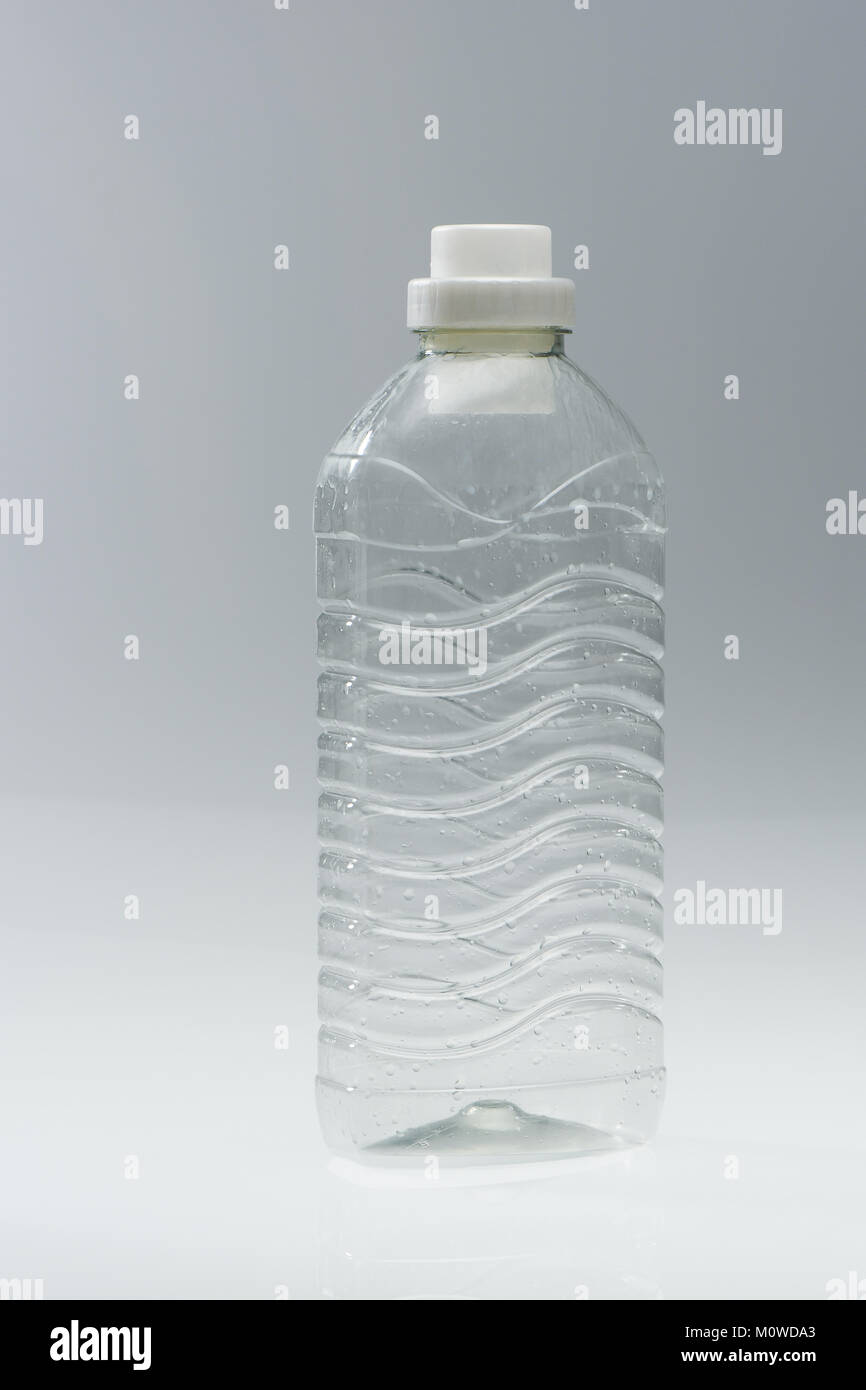 A range of plastic drinking bottles empty and non labelled ready for recycling on white background. - Stock Image