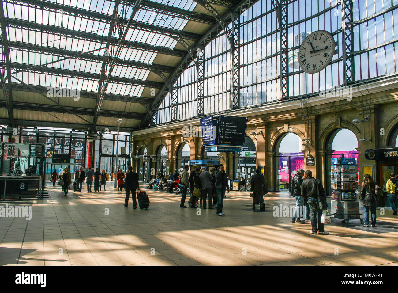 LIVERPOOL, ENGLAND - APRIL 20, 2012 : crowd people at Liverpool Lime Street train station - Stock Image