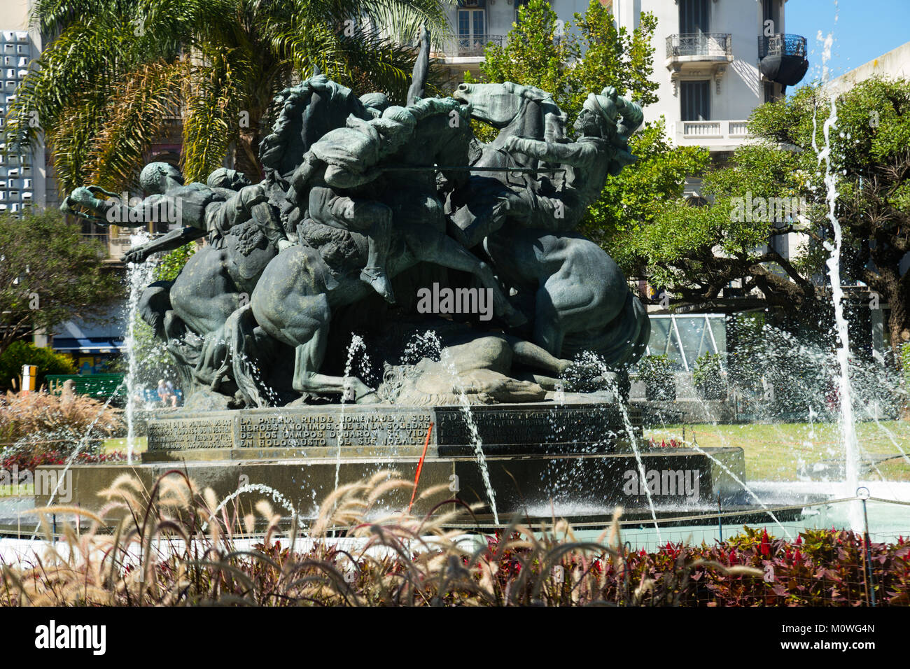 Juan Pedro Fabini square (Plaza Juan Pedro Fabini) with historic memorial to heroes and fountain in Montevideo. Stock Photo