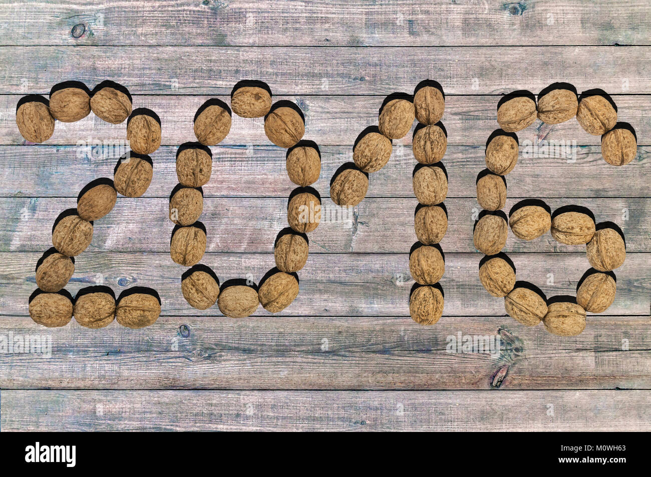 New year 2016 number made od dry walnut on wooden background Stock Photo