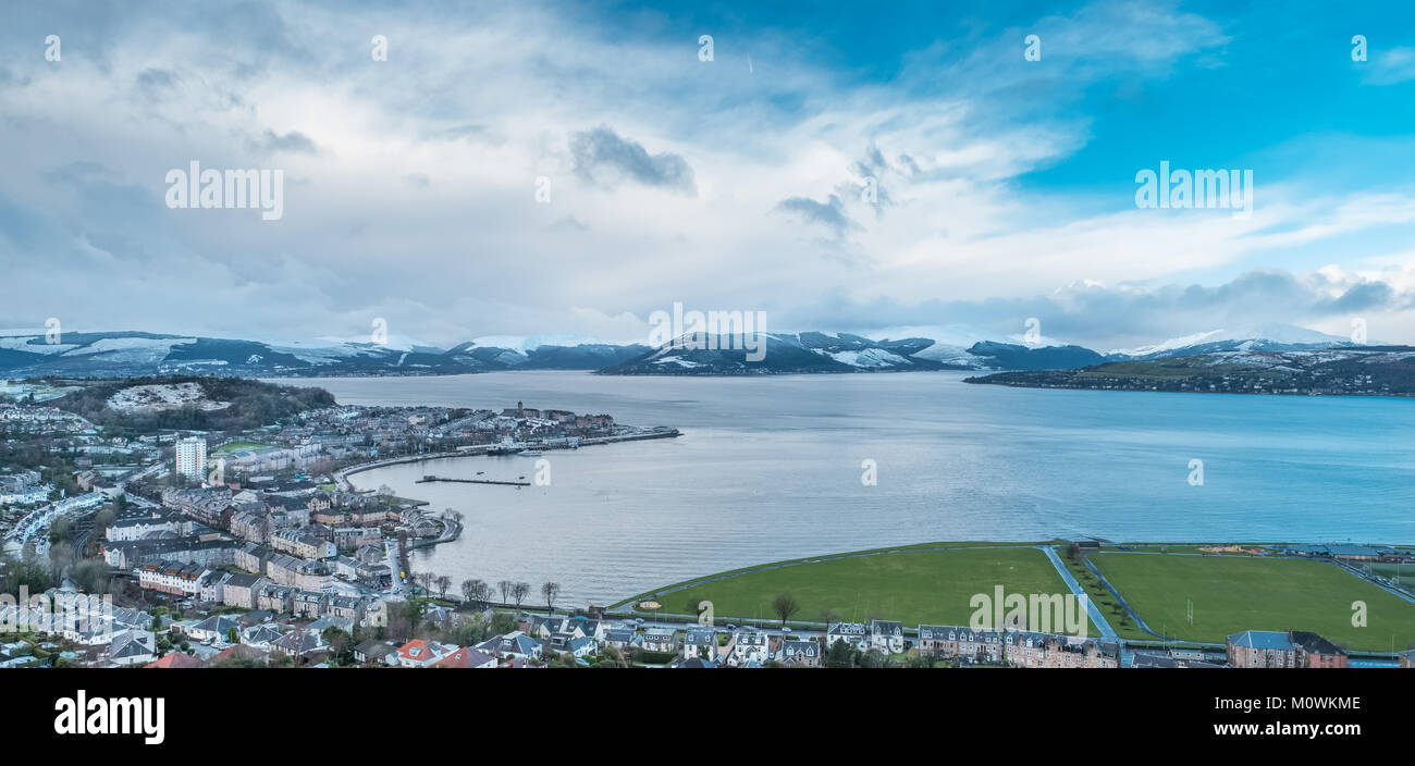 The scene from Lyle Hill Greenock looking over Gourock and onto Gareloch and its hillside covered in Snow. - Stock Image