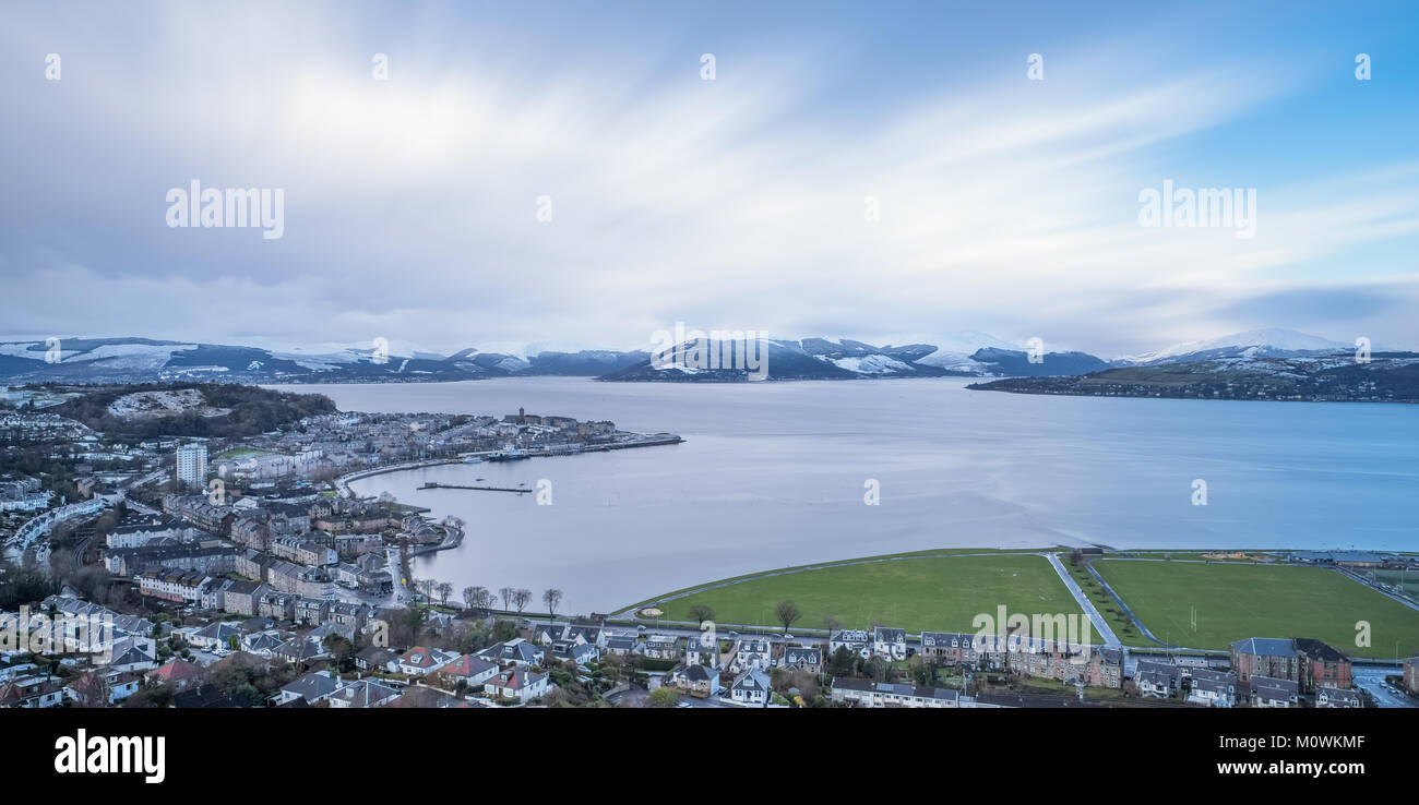 The scene from Lyle Hill Greenock looking over Gourock and onto Gareloch and its hillside covered in Snow. A long - Stock Image