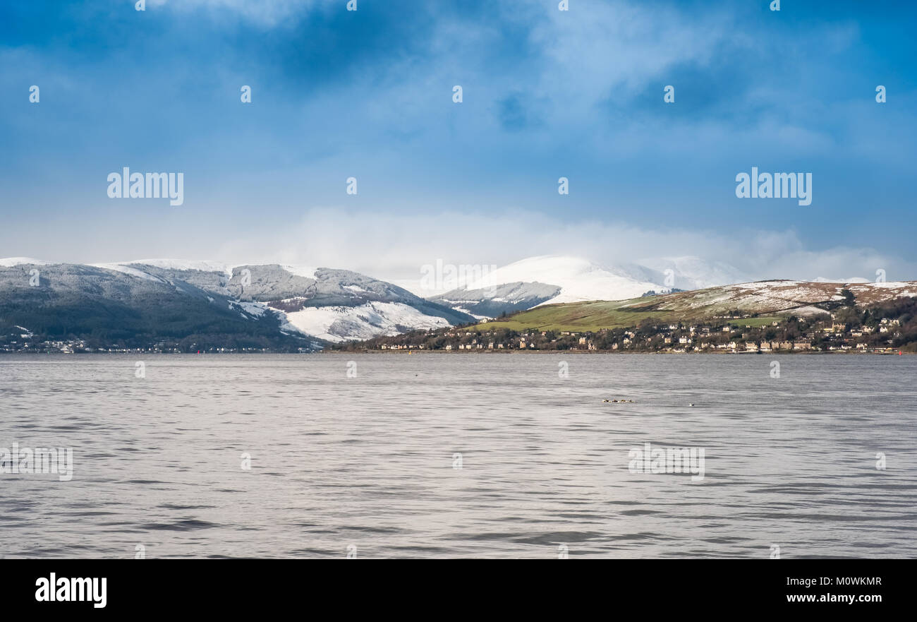 Looking over and up from Greenock Esplanade (Splash) on a cold winters day towards towards the snow covered hills - Stock Image