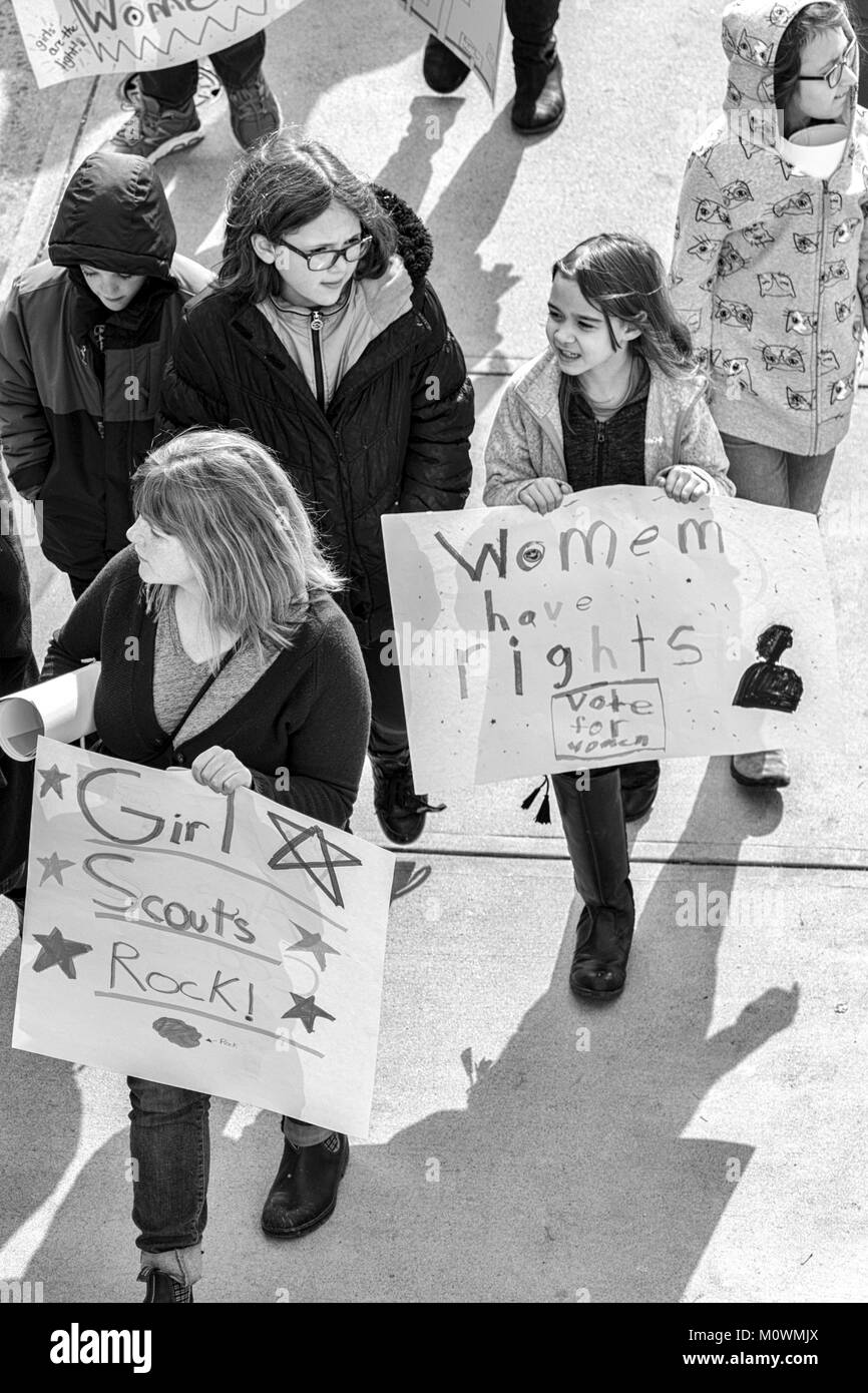 Young girls hold signs and walk downtown at the Women's March of 2018 in Asheville, North Carolina - Stock Image