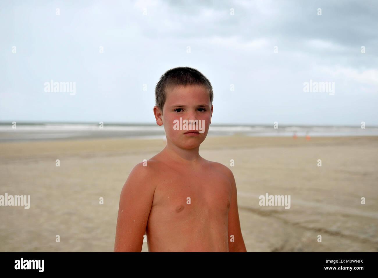 Boy on Beach - Stock Image