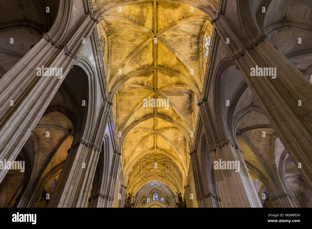 Ceiling and columns of the Cathedral of Seville, Andalusia, Spain. - Stock Image