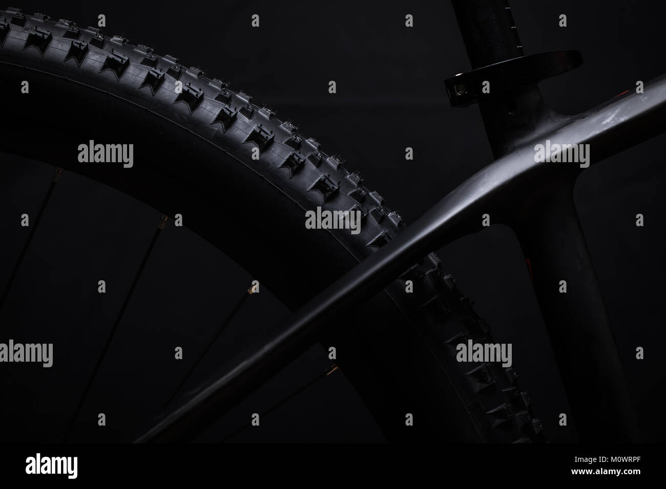 Modern MTB race mountain bike isolated on black background in a studio - Stock Image