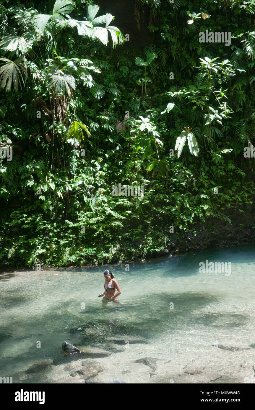 Costa Rica,Alajuela Province,La Fortuna,woman in the river Catarata de la Fortuna - Stock Image