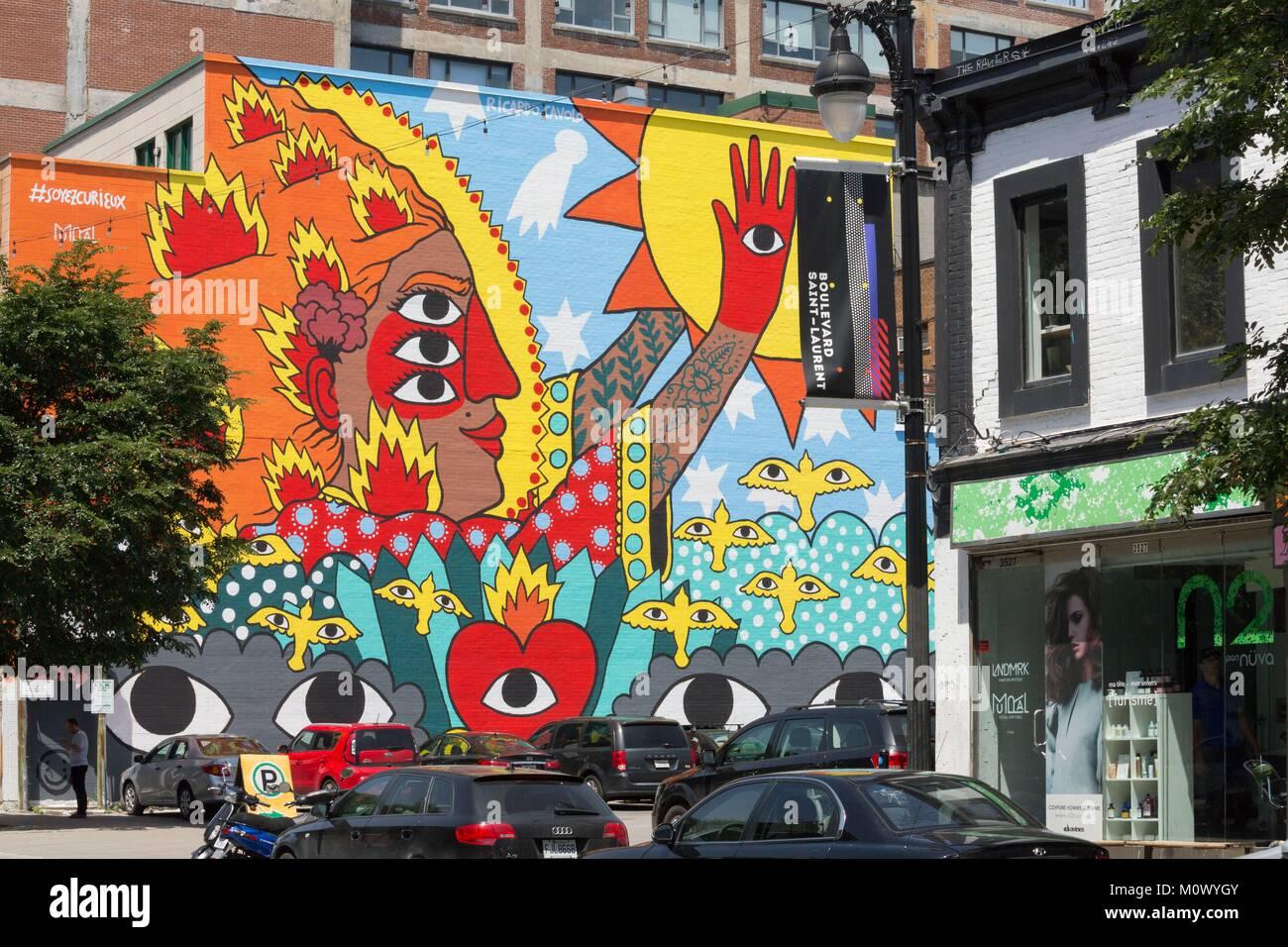 Canada,Quebec province,Montreal,Plateau-Mont-Royal,Boulevard Saint-Laurent,mural Be Curious by Ricardo Cavolo (2017) - Stock Image