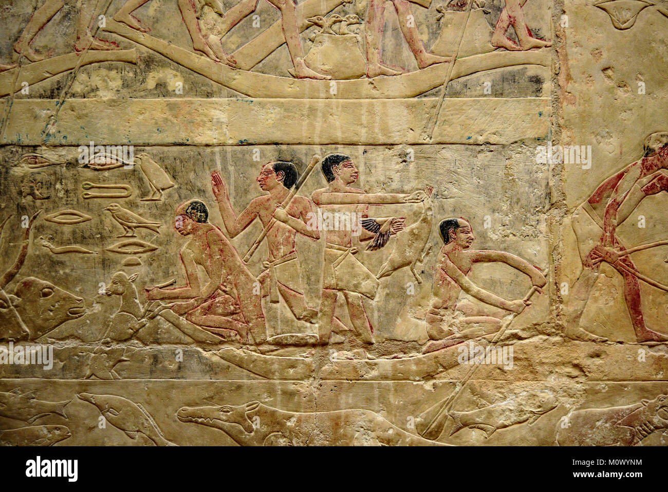 Ancient Egyptian hieroglyphic wall mural and stele depicting Stock