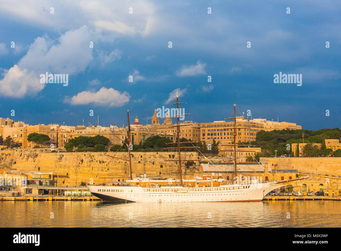 Malta,Valletta,city listed as World Heritage by UNESCO,Grand Harbour,cruising sailboat - Stock Image