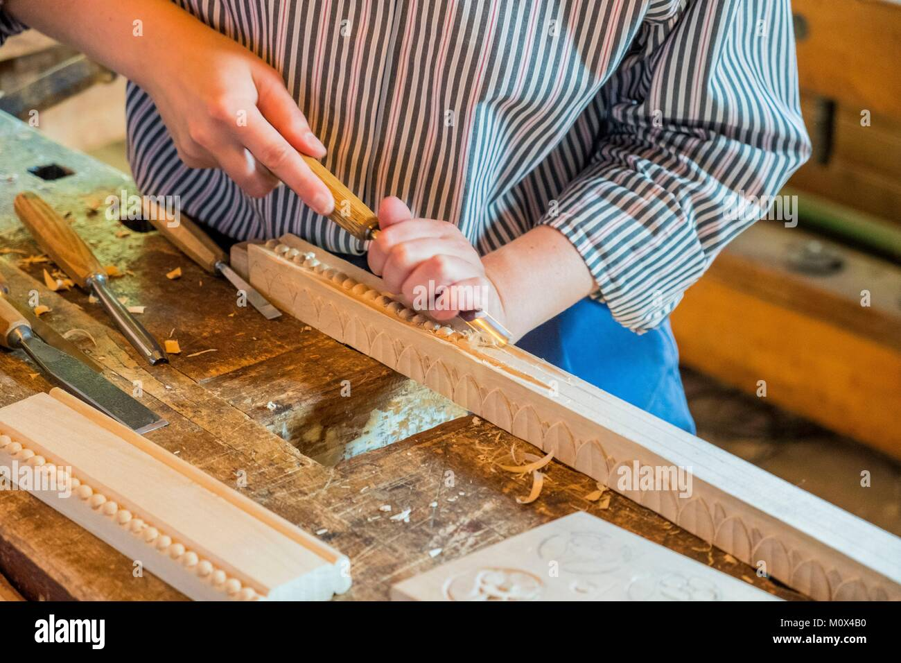 Sweden,Stockholm,Isle of Djurgarden,Skansen's open-air museum created in 1891,traces the life of yesteryear,woodworking - Stock Image