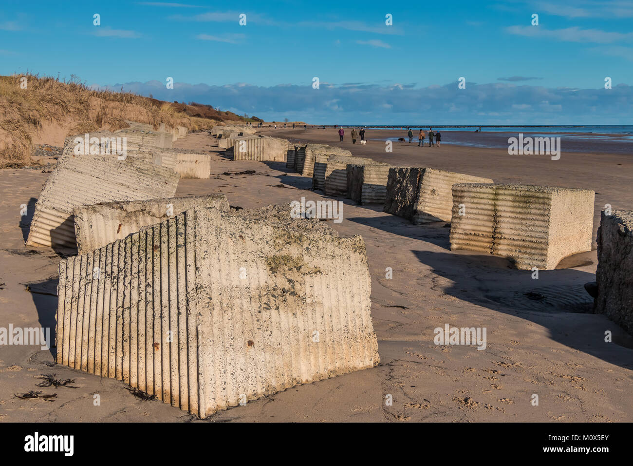 World War II beach defence obstacles at Alnmouth, Northumberland, UK, with copy space - Stock Image