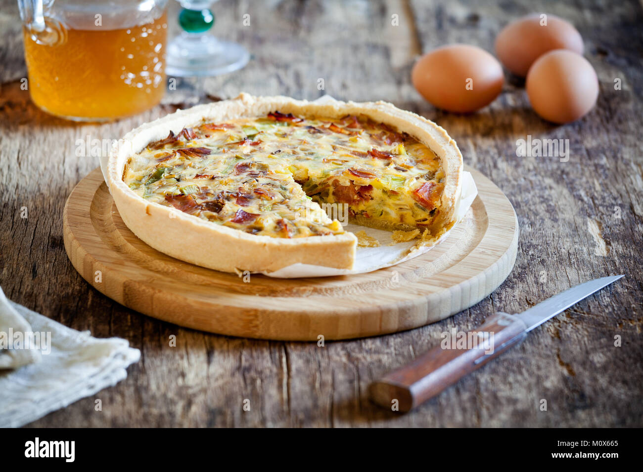 Simple homemade leek onion and bacon pie - Stock Image