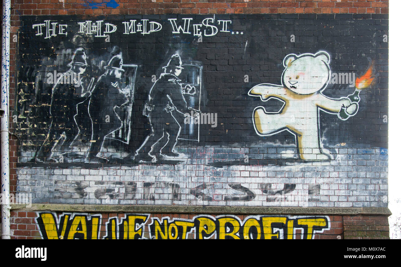 Stokes Croft, Bristol, including the famous Banksy art work 'The Mild Mild West' - Stock Image