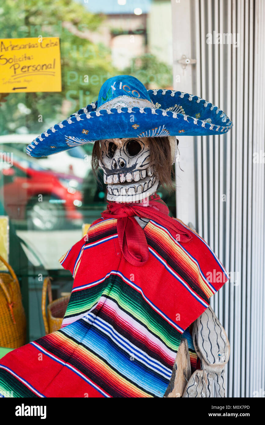A fun imitation skeleton dressed in Traditional Mexican costume, Market 28, Cancun, Mexico - Stock Image
