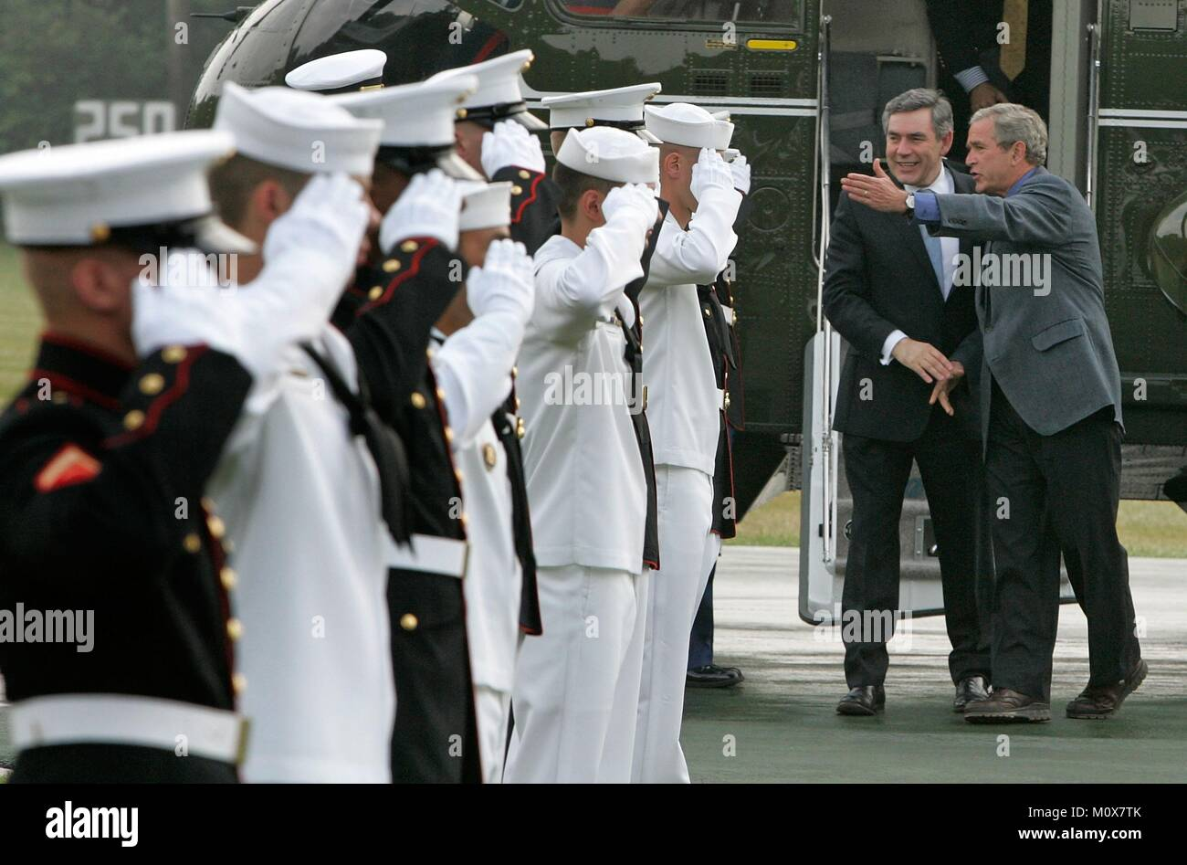 CAMP DAVID, MD - JULY 29: (AFP OUT) Members of the Military salute U.S. President George W. Bush (R) as he greets - Stock Image