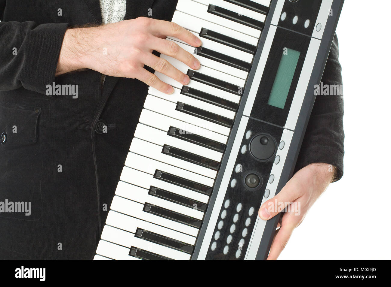 Music synthesizer in male hand - Stock Image