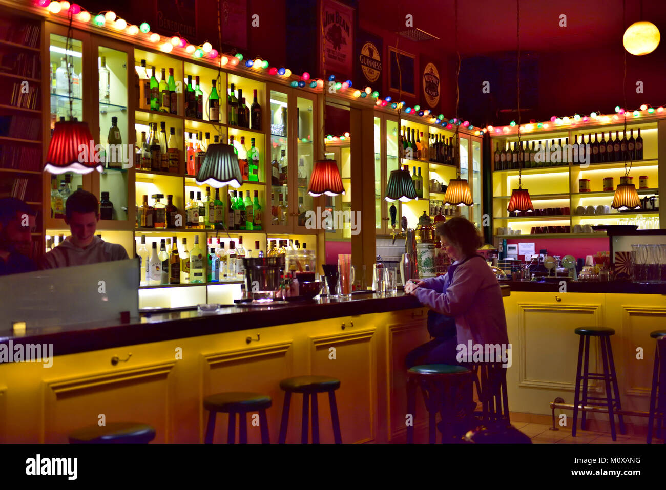 Inside bar central Athens near Monastiraki square with drinks on the counter - Stock Image