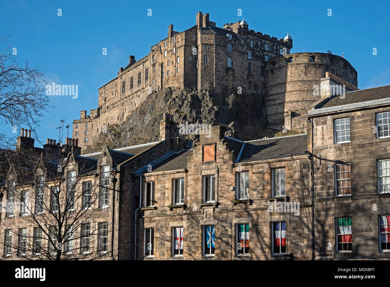 Edinburgh Castle seen from the Grassmarket in the Old Town. - Stock Image