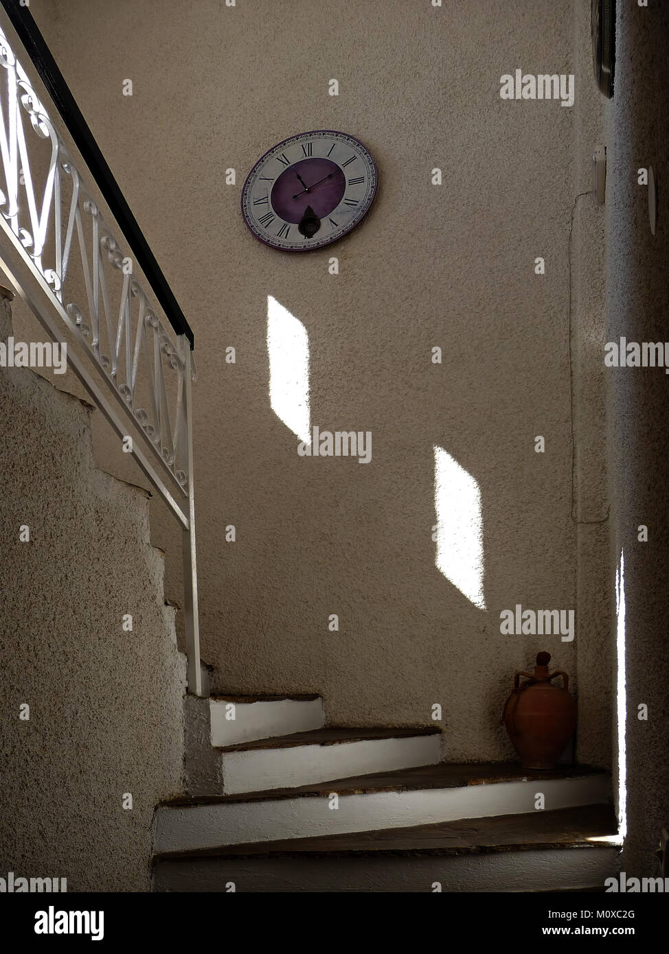 Interior Decoration White Stairs Clock On The Wall Vase In The