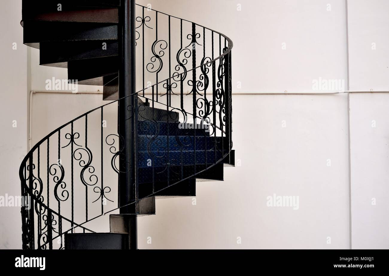 Elegant Metal Exterior Spiral Staircase On The Side Of A House In Singapore    Stock Image