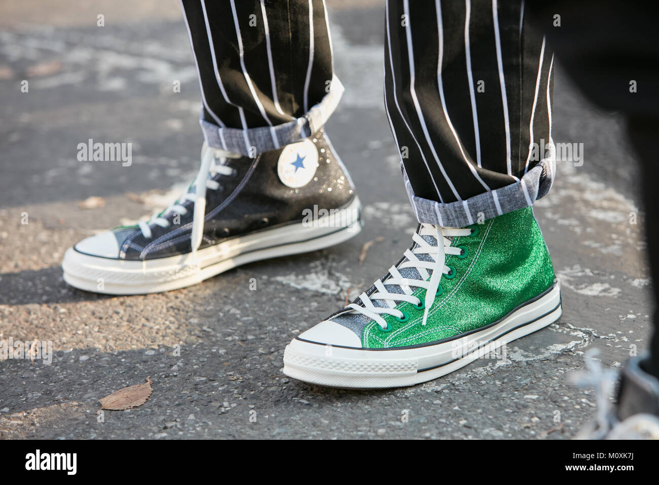 de00a728 MILAN - JANUARY 13: Man with green Converse All Stars glitter sneakers and  black and white striped trousers before Diesel Black Gold fashion show, Mil