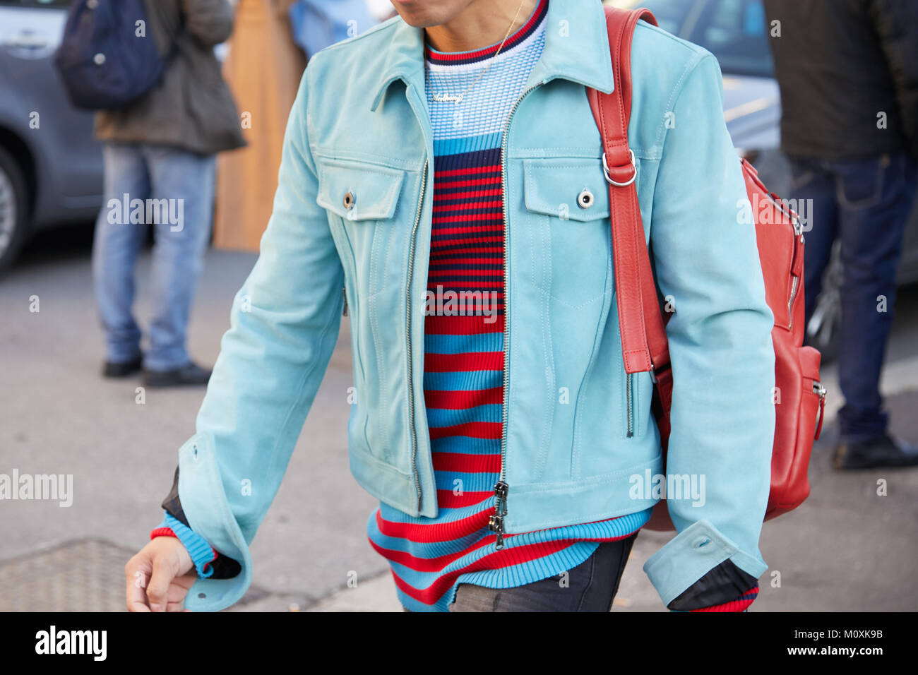4fd88695d7d MILAN - JANUARY 13  Man with light blue jacket and red, blue striped sweater