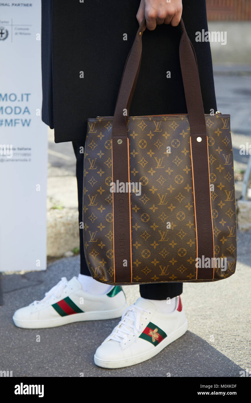 Louis Vuitton bag and white Gucci shoes