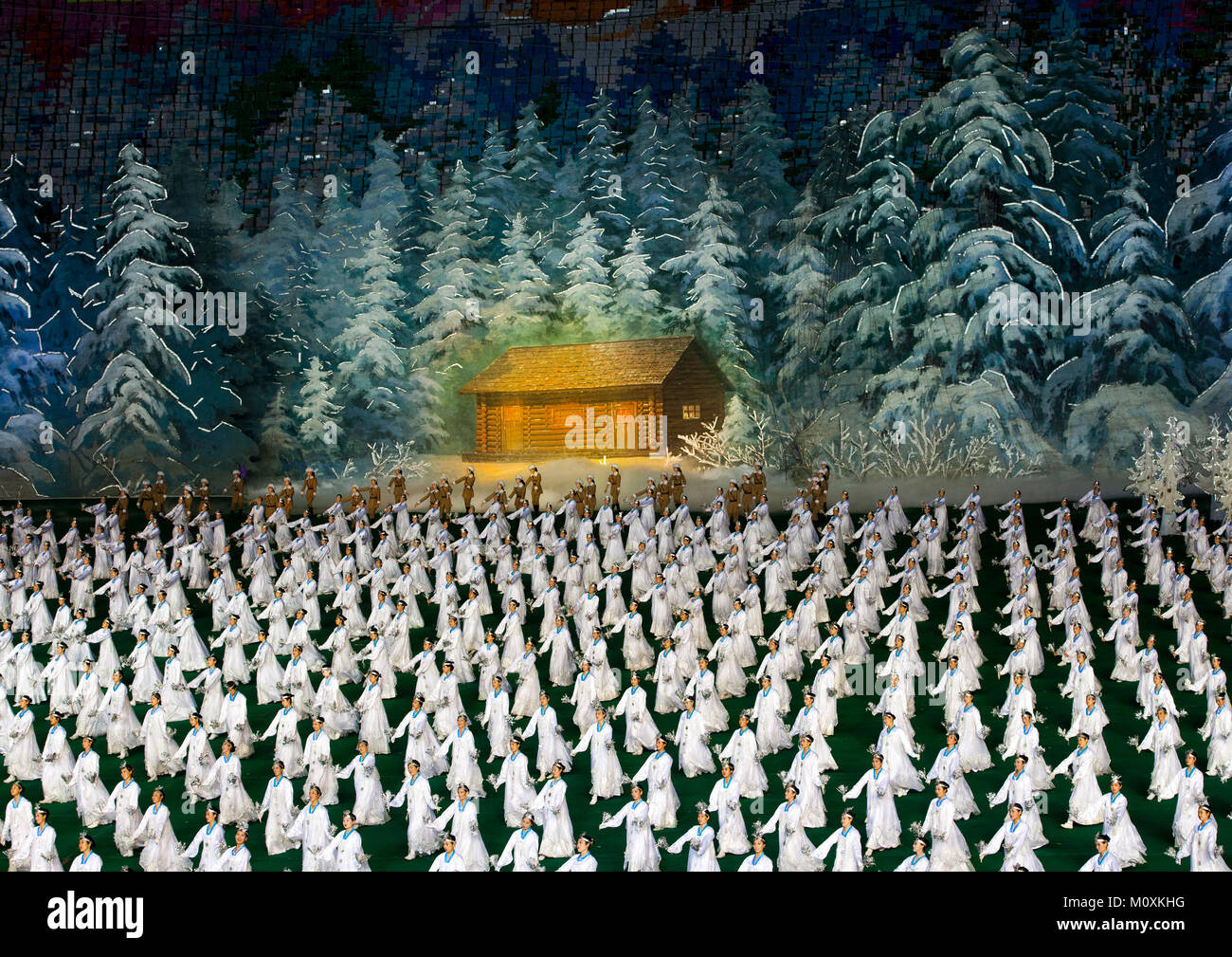 North Korean dancers performing in front of Kim Jong il native house during Arirang mass games in may day stadium, - Stock Image