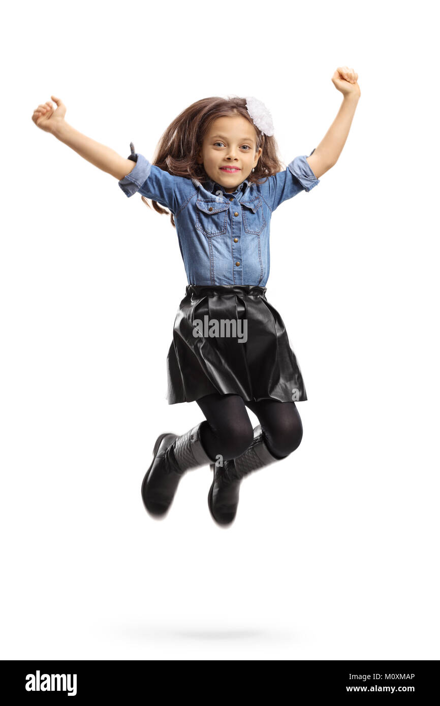 Joyful little girl jumping isolated on white background - Stock Image