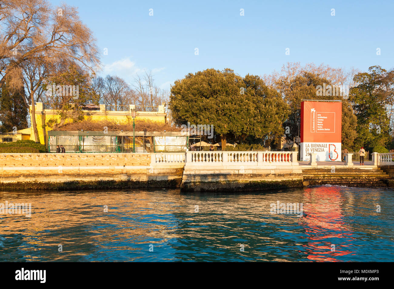 The Giardini Pubblici or Bieannale Gardens with thei signage and the popular Cafe Paradiso at sunset from the lagoon, Castello, Venice, Veneto, Italy Stock Photo