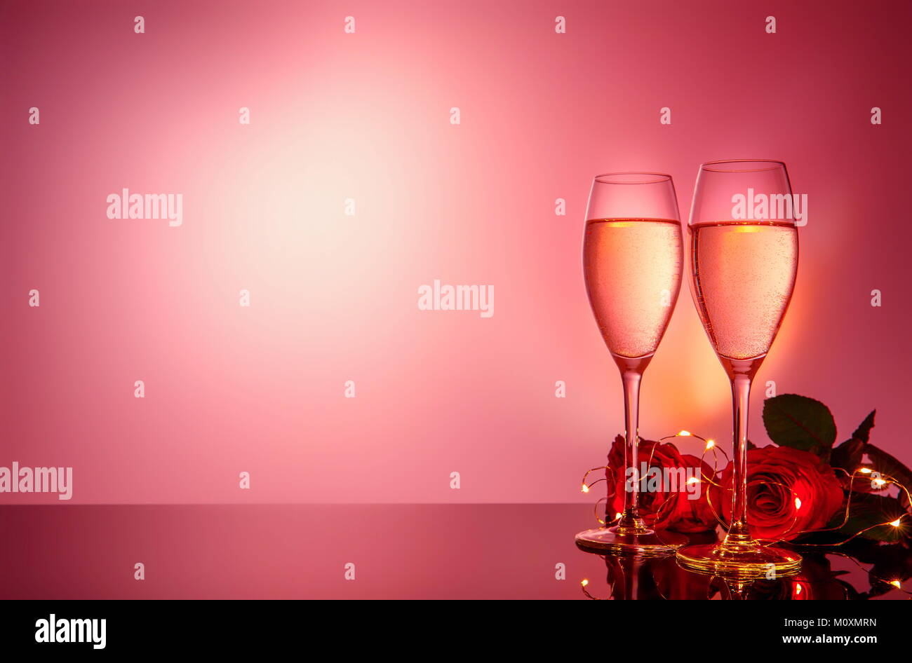 Champagne Glasses Red Roses In Front Of Pink Beige Background Valentines Day Holiday Composition