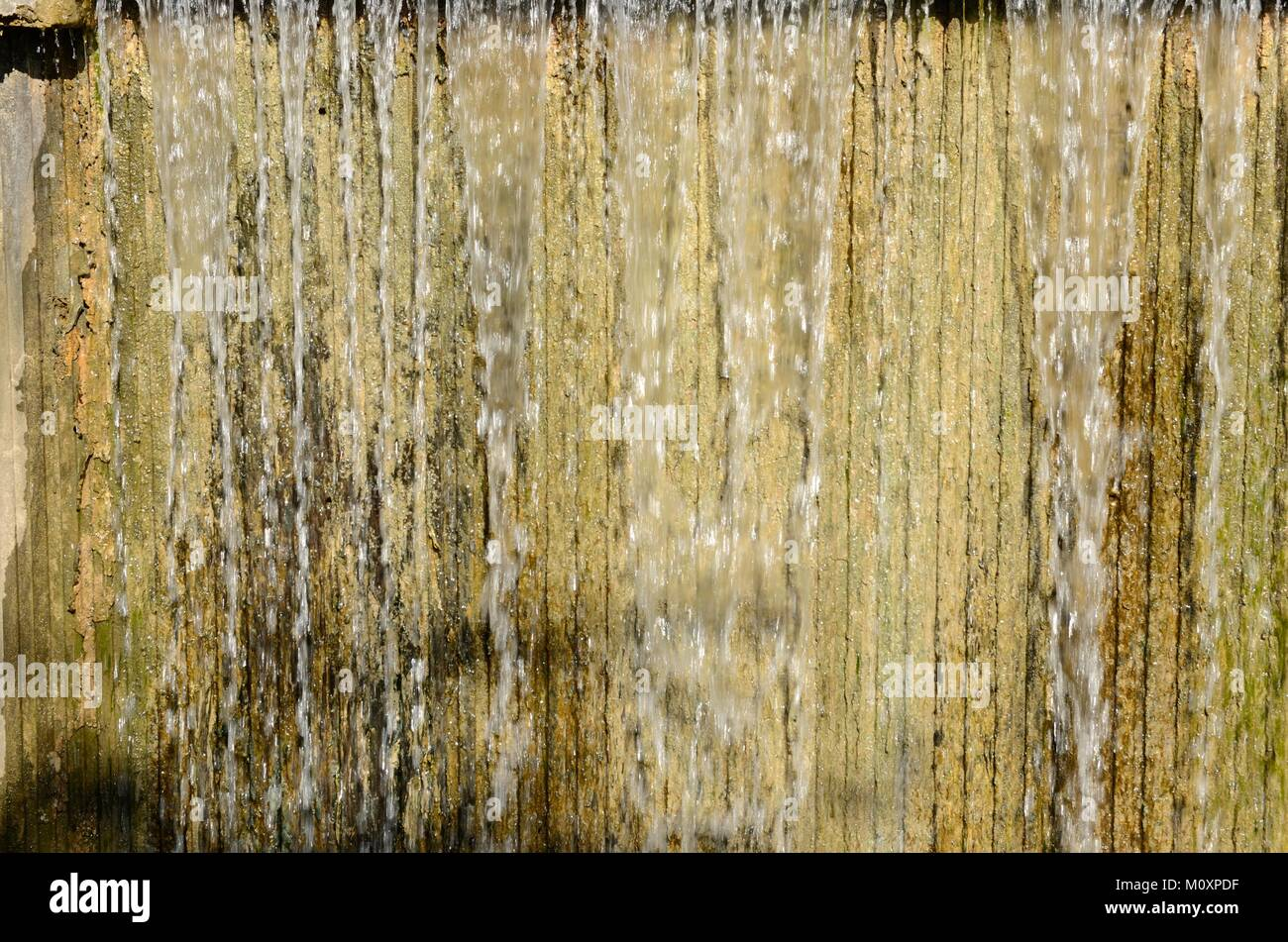 Water curtain at pond located in Island of the Carthusians in Seville, Andalusia, Spain. - Stock Image