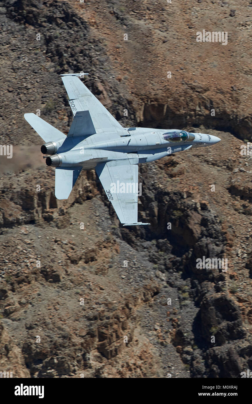 United States Navy F/A-18C, Hornet, Jet Fighter Bomber, Flying At High Speed And Low Level Through A Desert Canyon. - Stock Image